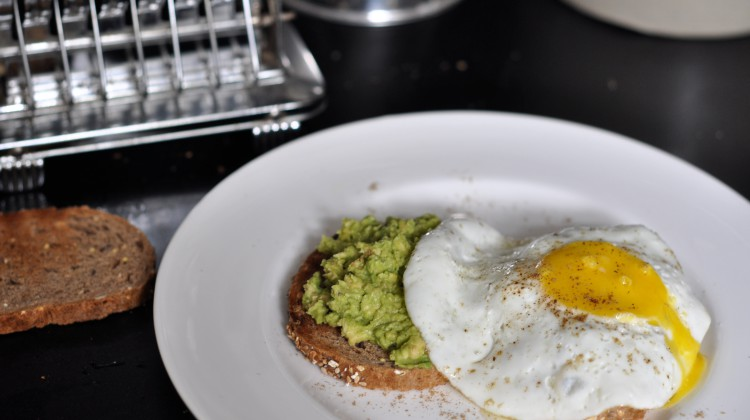 Toast with smashed avocado and baked egg